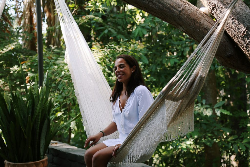 woman in hammock after IV Therapy session relaxing
